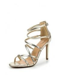 Женские золотые кожаные босоножки на каблуке от Aldo