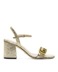 Золотые кожаные босоножки на каблуке от Gucci