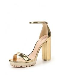Женские золотые кожаные босоножки на каблуке от Just Couture