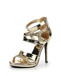 Золотые кожаные босоножки на каблуке от La Bottine Souriante