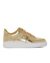 Женские золотые кожаные низкие кеды от Nike