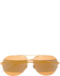 Женские золотые солнцезащитные очки от Christian Dior