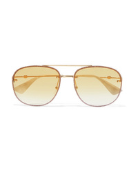Женские золотые солнцезащитные очки от Gucci
