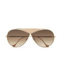 Женские золотые солнцезащитные очки от Loewe