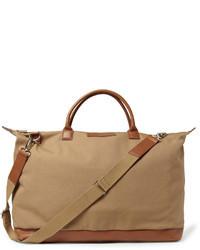 Коричневая дорожная сумка из плотной ткани