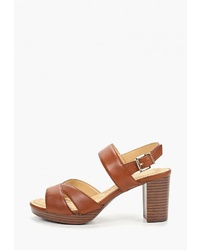 Коричневые кожаные босоножки на каблуке от Caprice