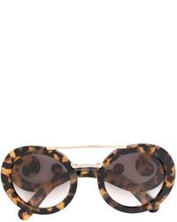 Женские коричневые солнцезащитные очки от Prada