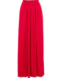 Красная длинная юбка со складками