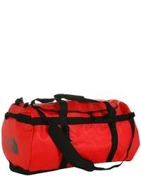 Красная дорожная сумка из плотной ткани