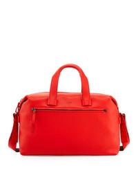 Красная кожаная дорожная сумка