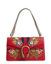 Красная кожаная сумка-саквояж с принтом
