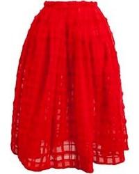 Красная пышная юбка с рельефным рисунком