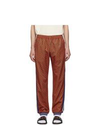 Мужские красные спортивные штаны в вертикальную полоску от Gucci