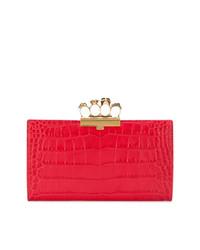 Красный кожаный клатч от Alexander McQueen