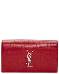Красный кожаный клатч от Saint Laurent