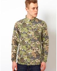 Оливковая джинсовая куртка с камуфляжным принтом