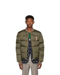 Мужская оливковая куртка-пуховик с вышивкой от Gucci