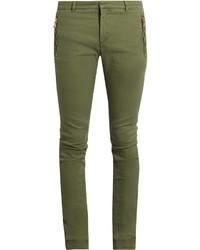 Оливковые зауженные джинсы