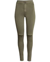 Оливковые рваные джинсы скинни