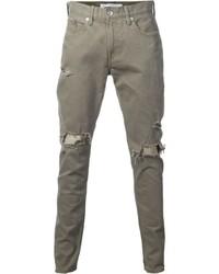 Оливковые рваные джинсы