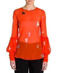 Оранжевая блузка с длинным рукавом с цветочным принтом