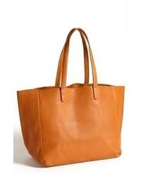 Оранжевая кожаная большая сумка