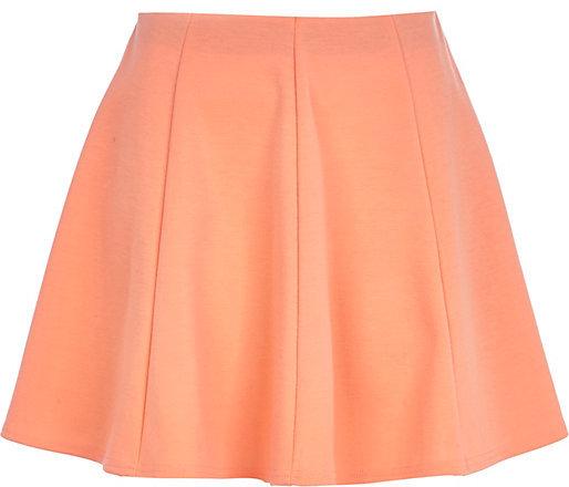 Короткая оранжевая юбка