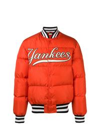 Мужская оранжевая куртка-пуховик от Gucci