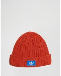 Мужская оранжевая шапка от adidas
