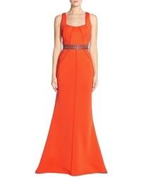 Оранжевое вечернее платье с украшением