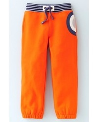 Оранжевые брюки