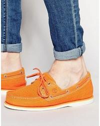 Оранжевые кожаные топсайдеры от Timberland