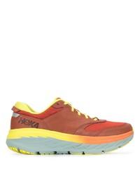 Мужские оранжевые кроссовки от Hoka One One