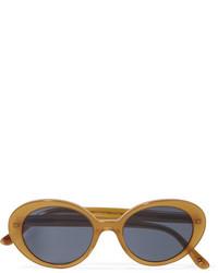 Женские оранжевые солнцезащитные очки от Oliver Peoples