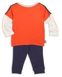 Оранжевые спортивные штаны