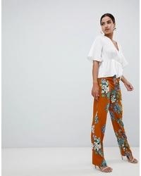 Оранжевые широкие брюки с цветочным принтом от Missguided