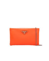 2f074aab8cee Купить оранжевый кожаный клатч Prada - модные модели клатчей ...