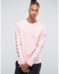 Розовая футболка с длинным рукавом с принтом