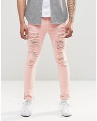 Розовые зауженные джинсы