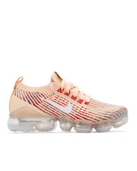 Женские розовые низкие кеды от Nike