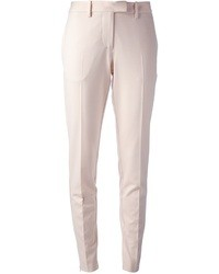 Розовые узкие брюки