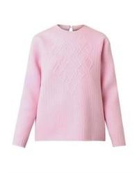 Розовый вязаный свитер
