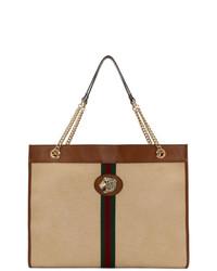 Светло-коричневая большая сумка из плотной ткани в вертикальную полоску от Gucci