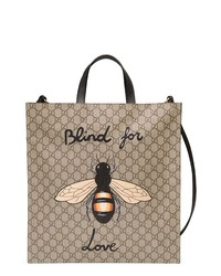 Светло-коричневая большая сумка из плотной ткани с принтом