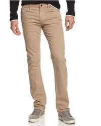 Светло-коричневые зауженные джинсы