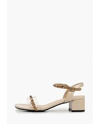 Светло-коричневые кожаные босоножки на каблуке от Chezoliny