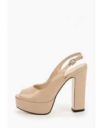 Светло-коричневые кожаные босоножки на каблуке от Diora.rim