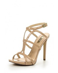 Женские светло-коричневые кожаные босоножки на каблуке от GUESS