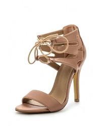 Женские светло-коричневые кожаные босоножки на каблуке от Spurr