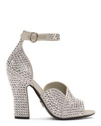Серебряные кожаные босоножки на каблуке с украшением от Prada